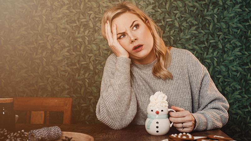 Woman avoid holiday stress via hot chocolate