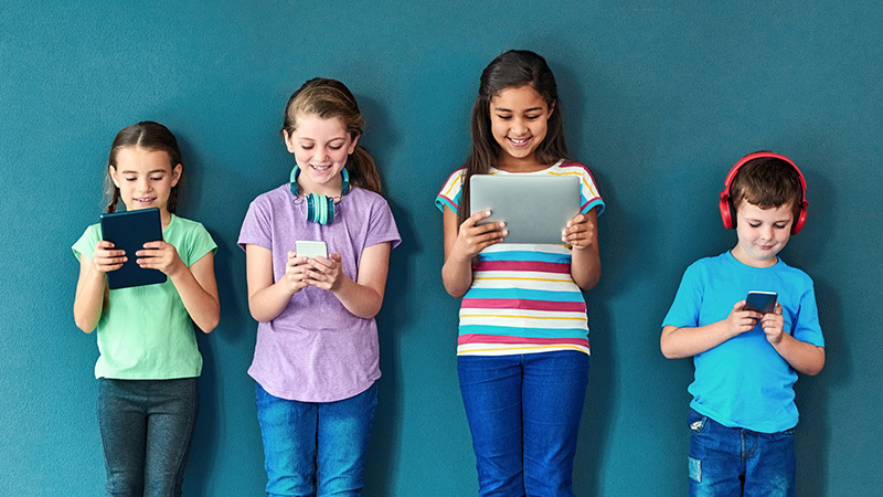 Podcasts for Kids, 4 students with devices